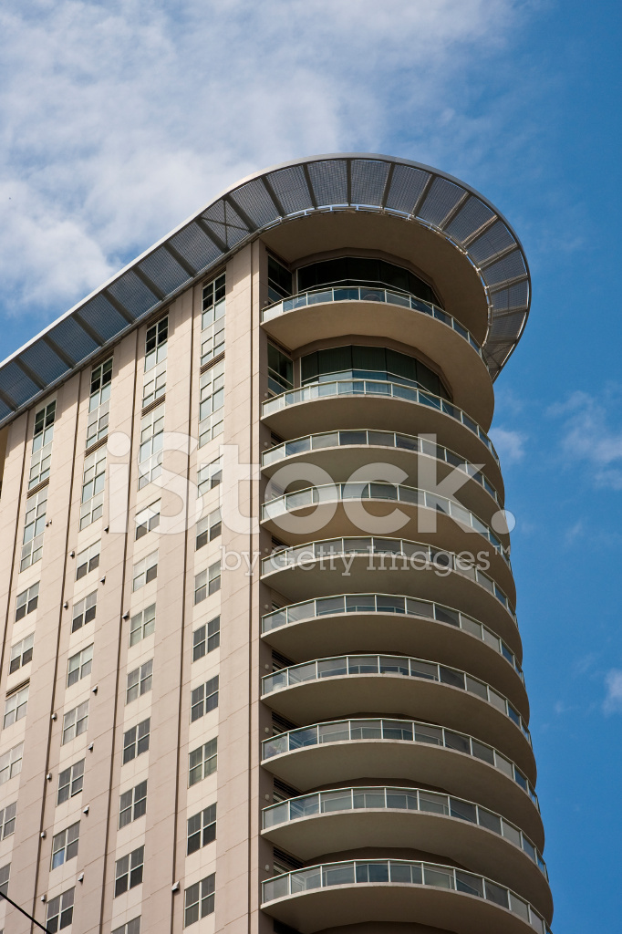 apartment tower with curved balconies stock photos