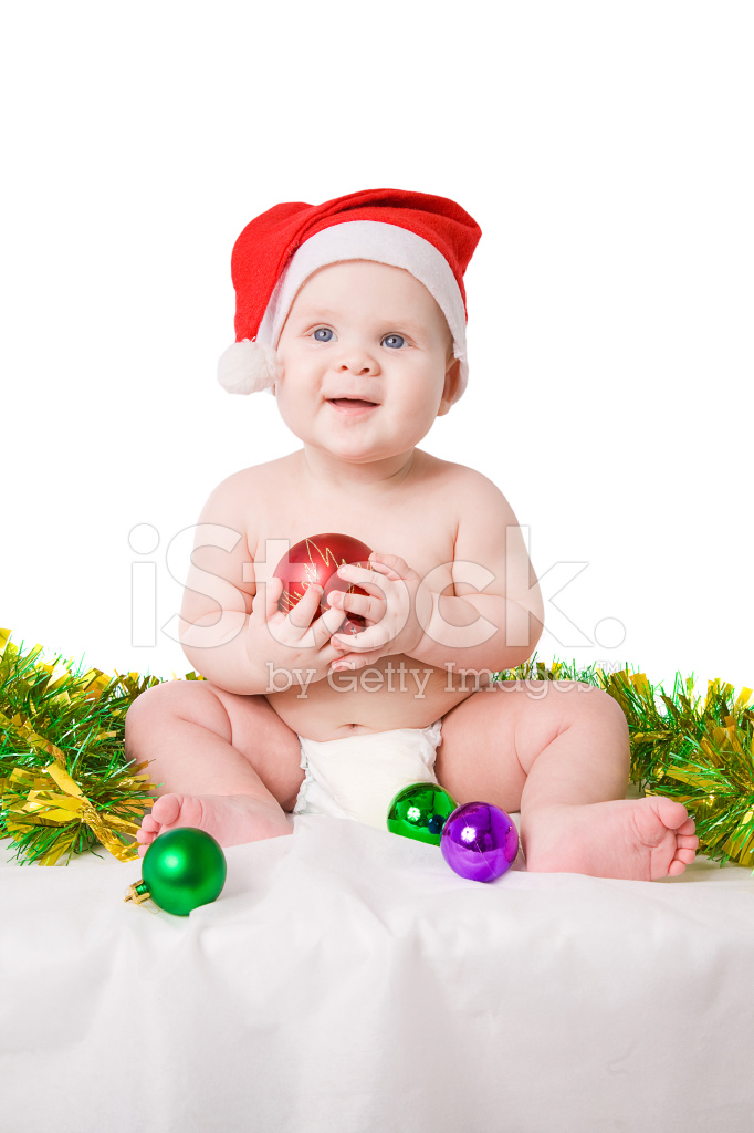 Baby In Santa Claus Hat Playing With Christmas Balls Stock