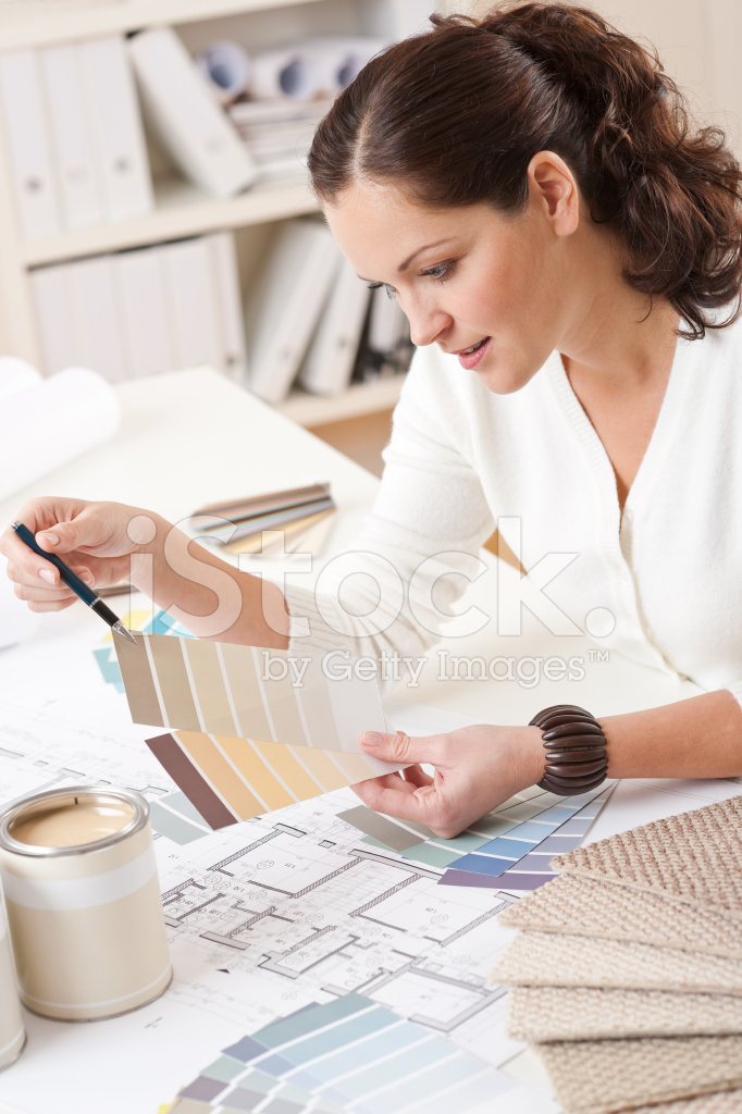 Successful Interior Designer Woman Working AT Office Stock