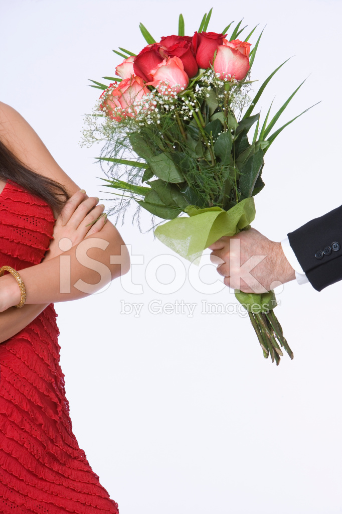 Man Offering Bouquet of Roses Stock Photos - FreeImages.com
