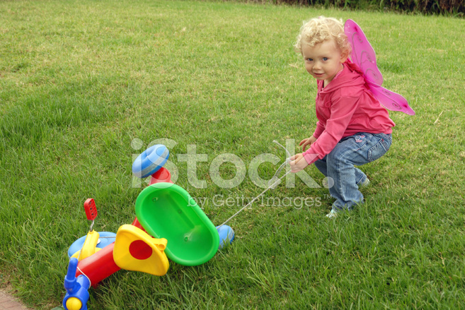 47782a663bd Little Blonde Girl Playing With Colorful Tricycle Stock Photos ...