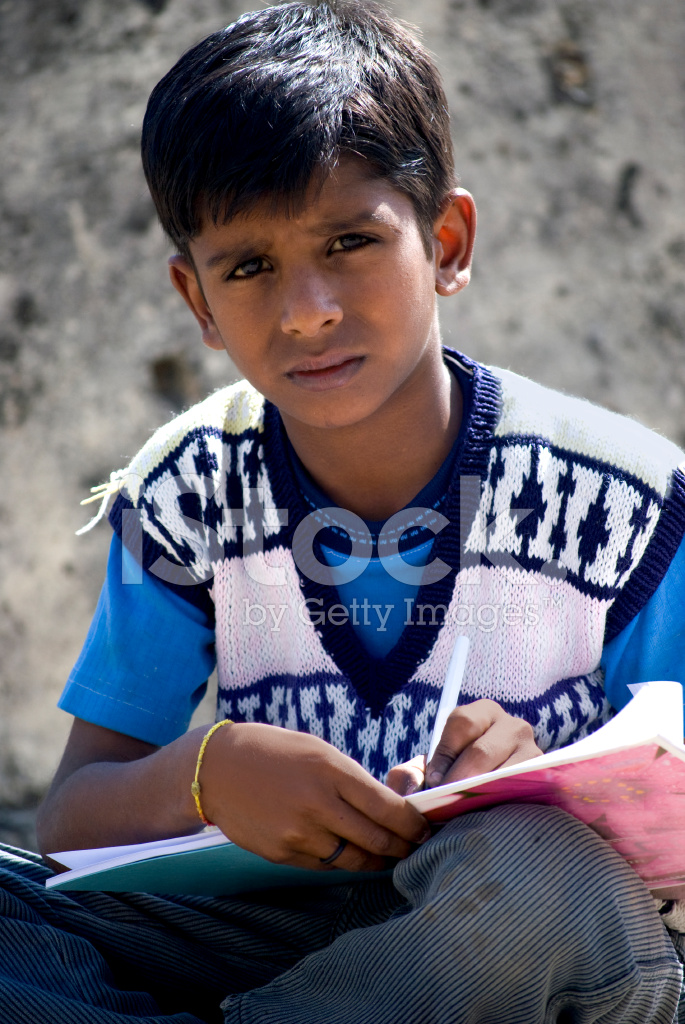 Indian School Boy Witing In Book Stock Photos - Freeimagescom-9181