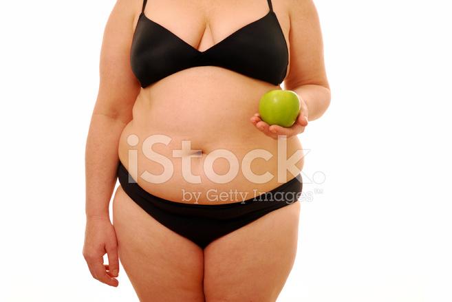12452998-fat-woman-holding-apple.jpg