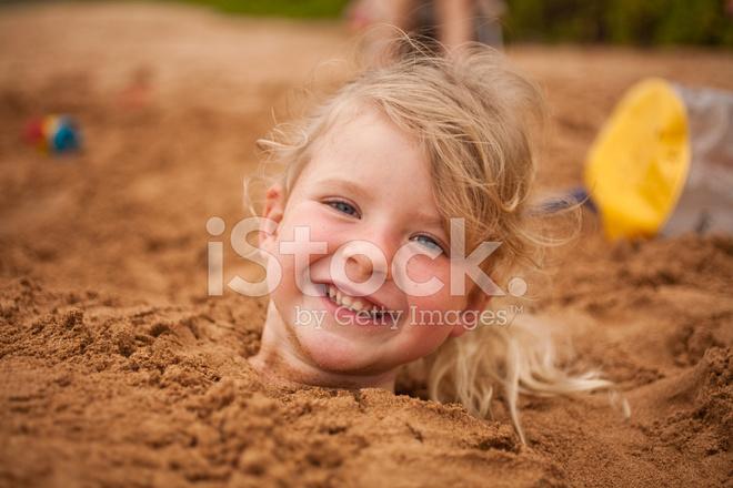 Girl Buried IN Sand Stock Photos FreeImagescom