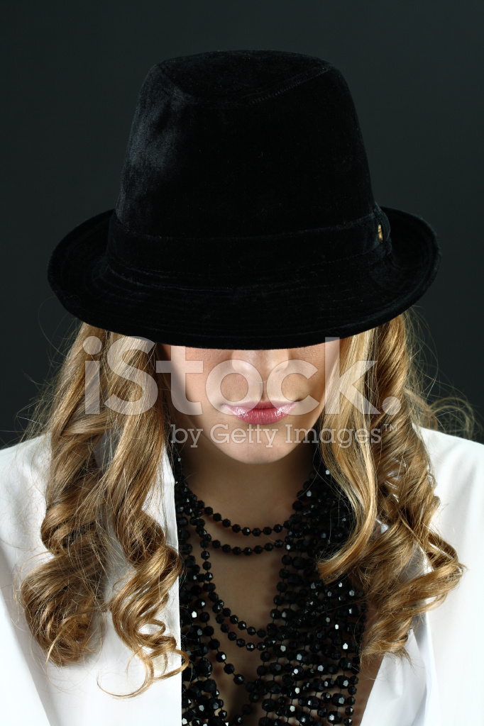 fba1d57f866 Girl IN White Shirt Hiding Her Face Under Black Hat Stock Photos ...
