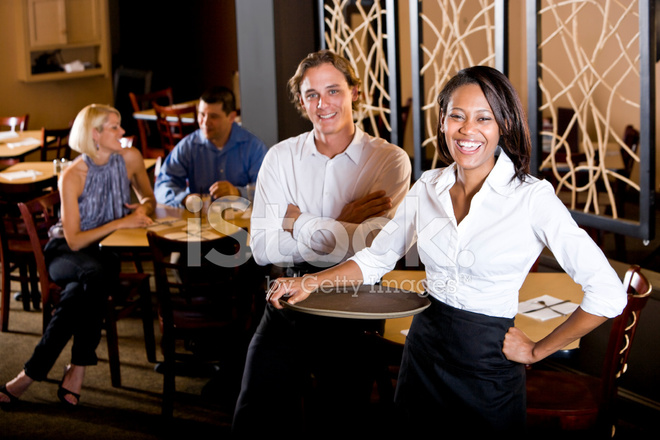 Friendly Multiracial Restaurant Waiters, Customers IN