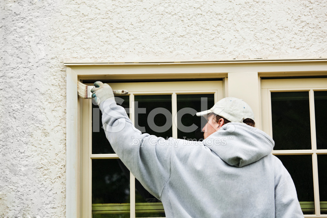 House Painter Painting Exterior Window Frame In Repair And