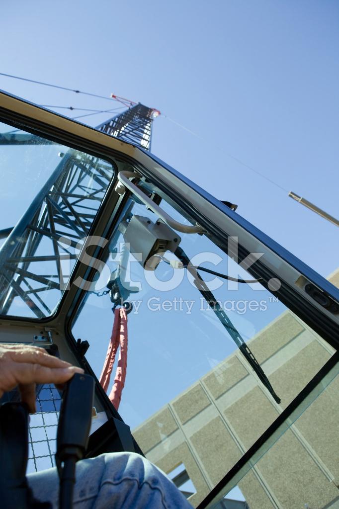 Crane Operator Raising New Roof Beam At Commercial