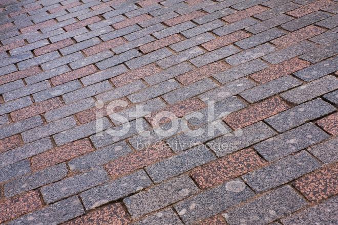 Vecchia pavimentazione di granito piastrelle mosaico fotografie