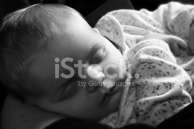 newborn baby sleeping black and white conversion stock