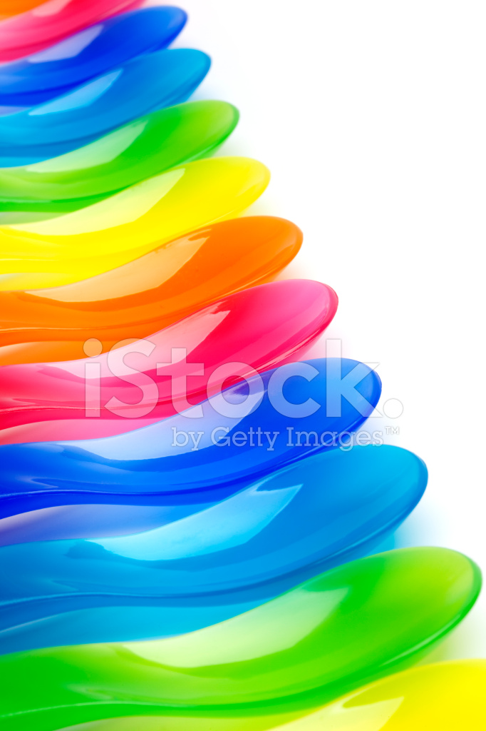 Colorful Spoons: Rainbow Colored Plastic Spoons Stock Photos