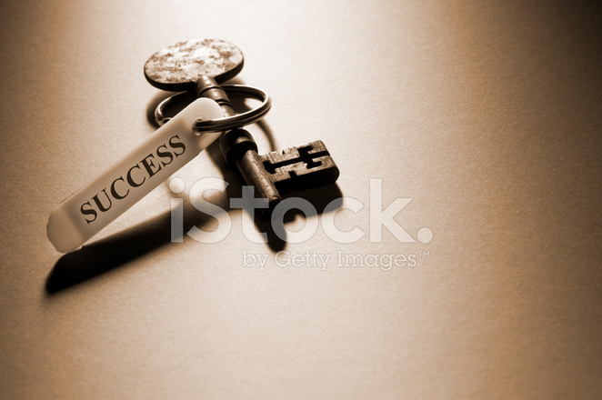 Old Key With Success on Key Fob With Copy Space Stock Photos