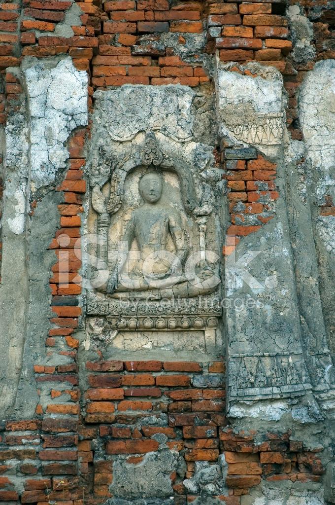 Buddha carving an wand stockfotos freeimages