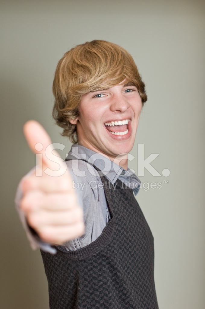 Happy young man showing his thumb up shouting for joy