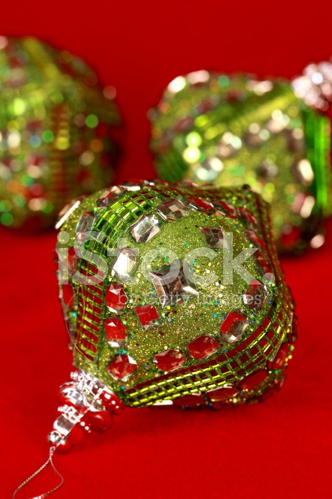 Green Jeweled Christmas Ornaments on Red - Green Jeweled Christmas Ornaments On Red Stock Photos - FreeImages.com