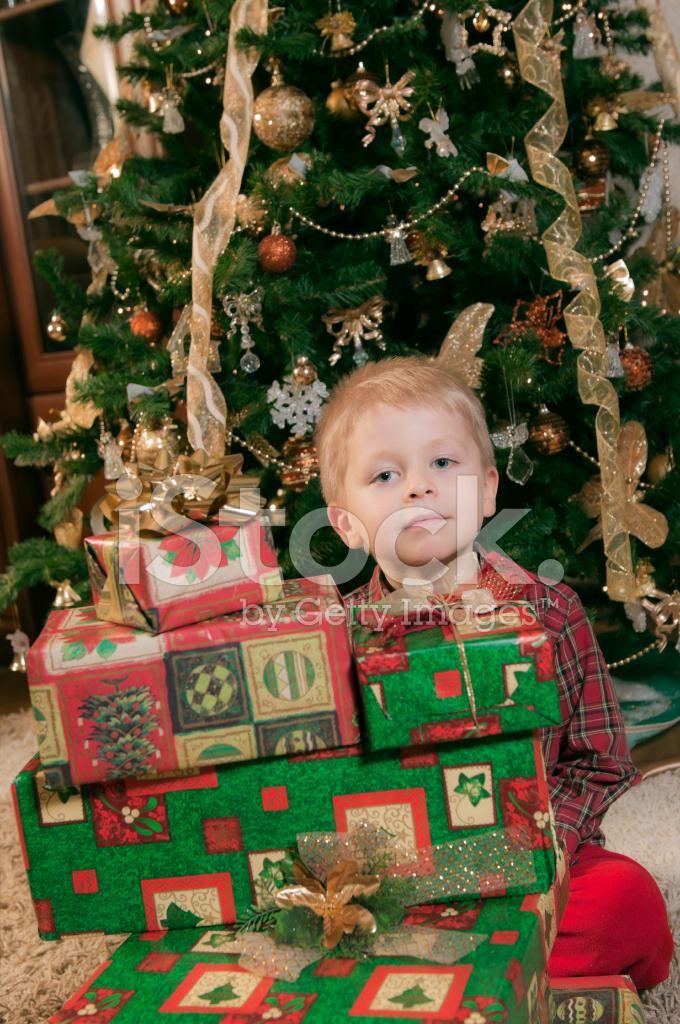 child with many gifts and christmas tree - How Many Gifts For Christmas