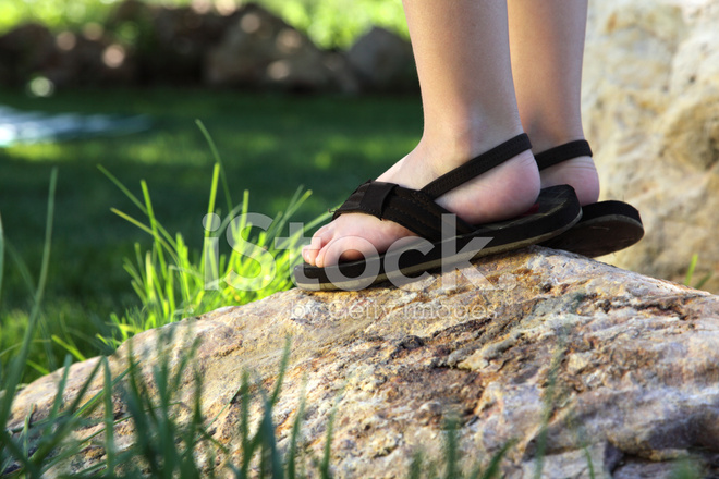 Close Up Of Little Boys Feet On A Rock Stock Photos