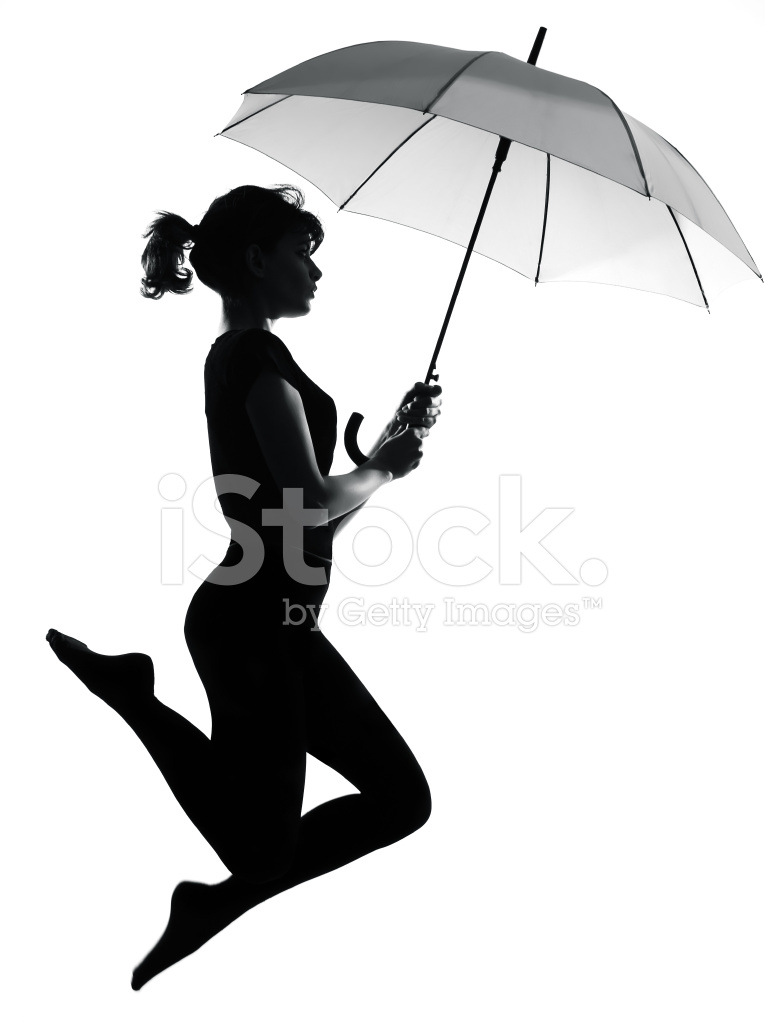 Silhouette Woman Flying Holding Open Umbrella Stock Photos ...