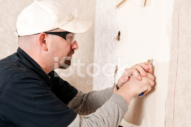[Image: 15494444-guy-cutting-sheetrock.jpg]