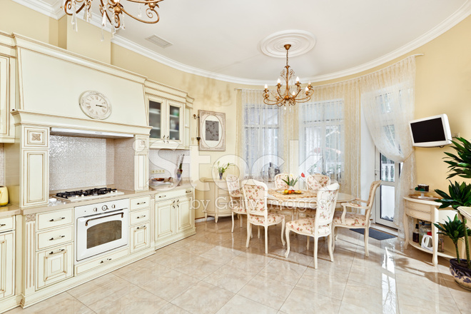 https://images.freeimages.com/images/premium/previews/1556/15567323-classic-style-kitchen-and-dining-room-interior-in-beige-colors.jpg