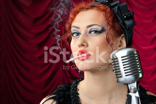 Redhead smoking thumbs