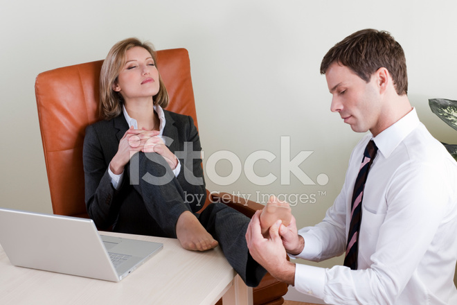 Female Manager Receiving Foot Massage Stock Photos