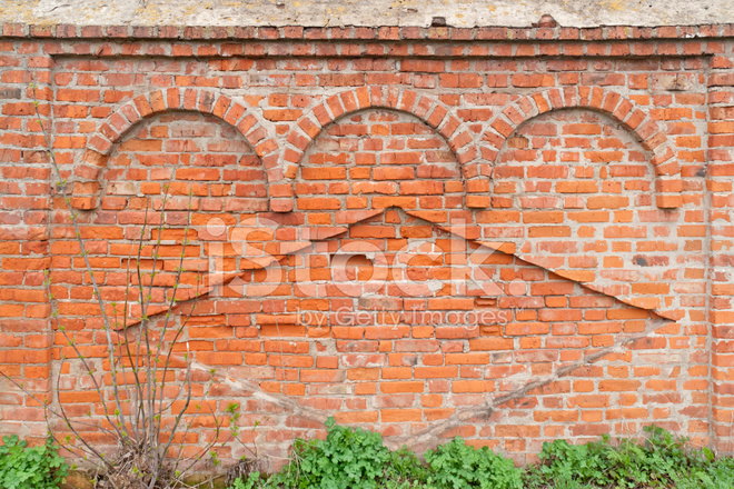 Ancient Cut Away Brick Wall With Decorative Arches And Rhomb