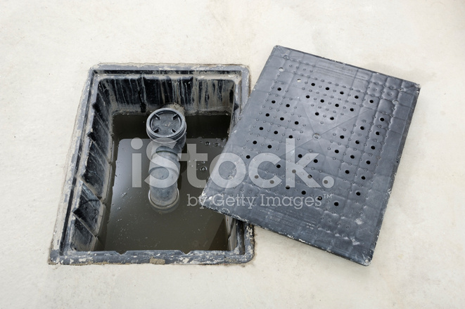 Open garage floor drain stock photos for Drain de garage installation