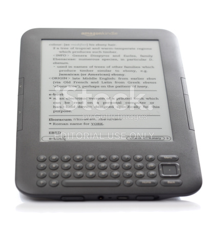 Kindle Device With E Book Definition on Screen Stock Photos