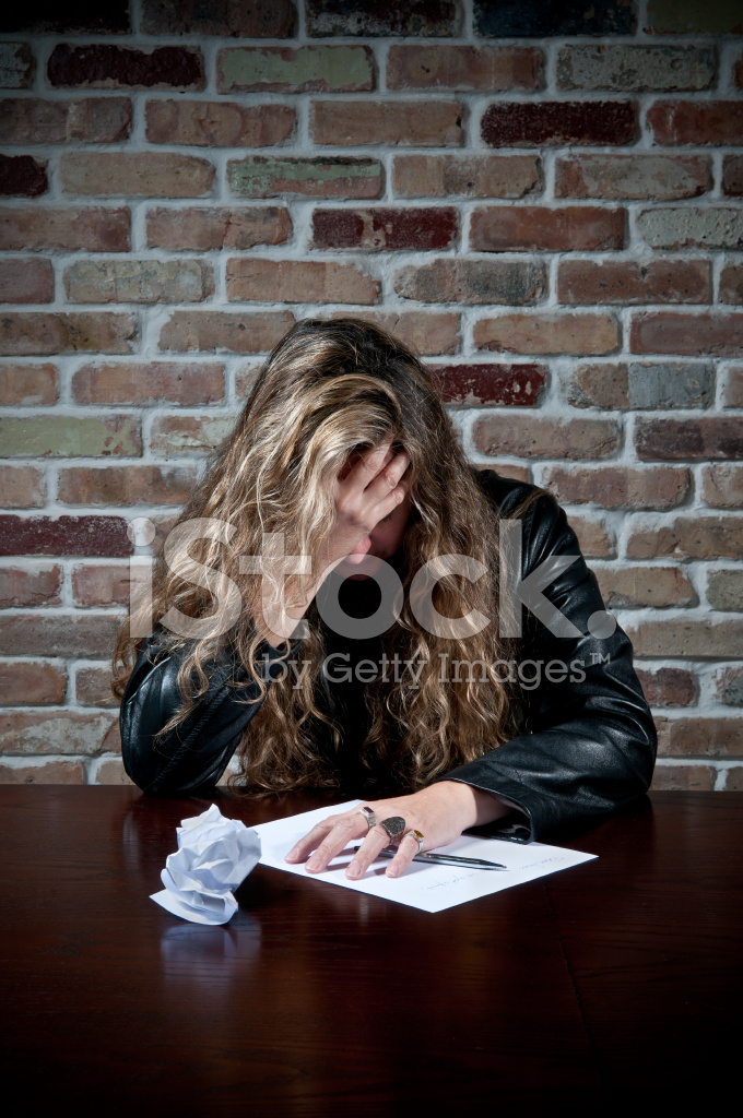 Sad woman trying to write a love letter stock photos freeimages sad woman trying to write a love letter expocarfo Choice Image