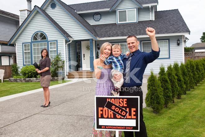 happy young family in front of their new house stock photos. Black Bedroom Furniture Sets. Home Design Ideas