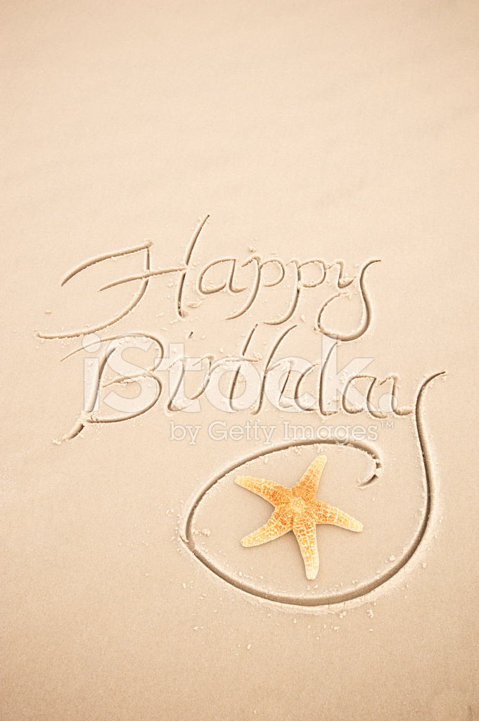 Happy Birthday Message With Starfish Handwritten On Sand Beach