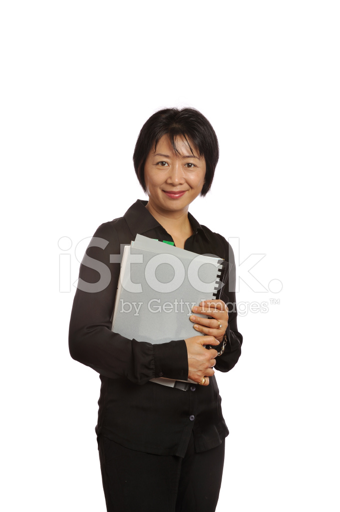 Asian professional business woman carrying documentation