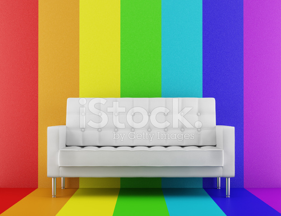 White Couch In Front Of Rainbow Multicolored Wall Stock Photos