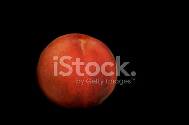 yellow peach on black background stock photos freeimages com yellow peach on black background stock