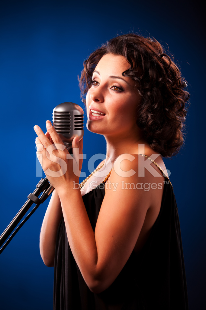 Singer Standing With Microphone Stock Photos - FreeImages.com