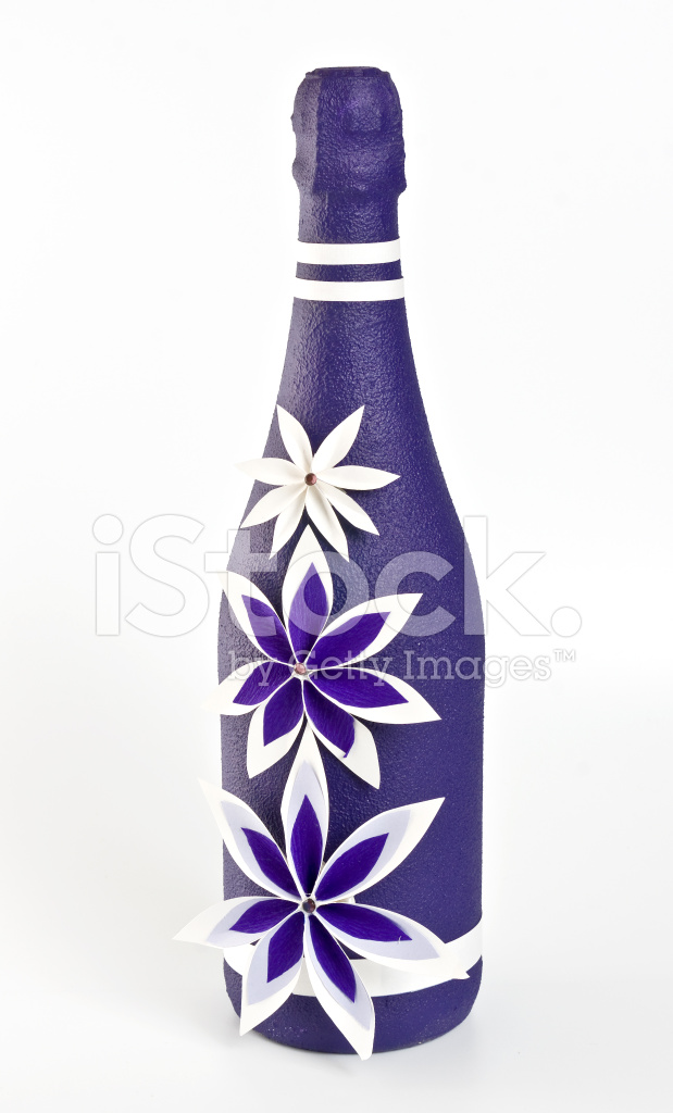 Bottle Of Champagne With Paper Purple And White Flowers Stock Photos