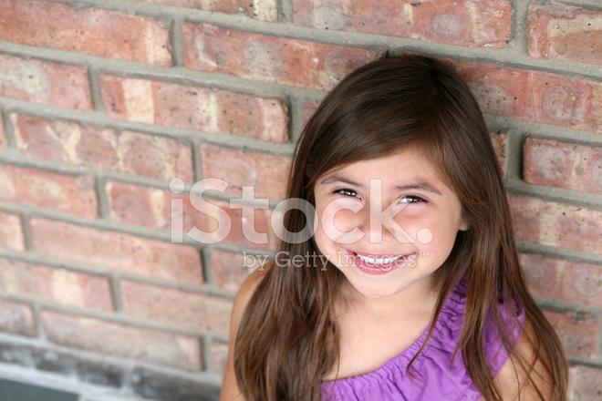 close up of hispanic little girl smiling stock photos