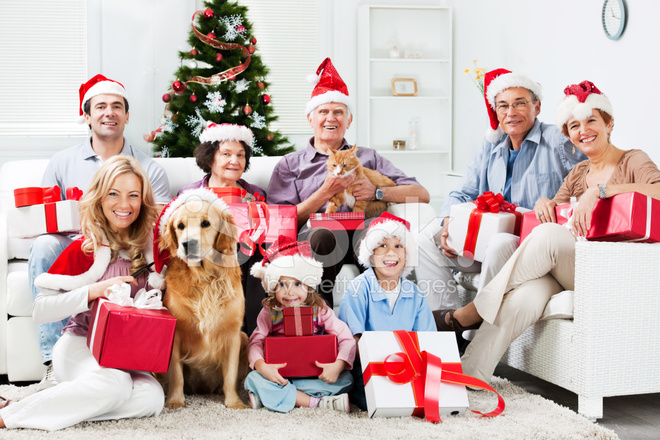 Extended Family With Their Pets Celebrating Stock Photos