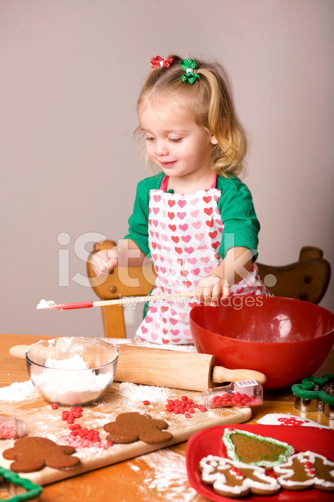 Toddler Girl Baking Christmas Cookies At Home Stock Photos