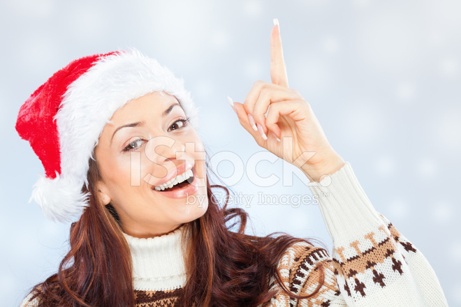 Woman With Santa Hat Pointing AT Blank Banner stock photos ...