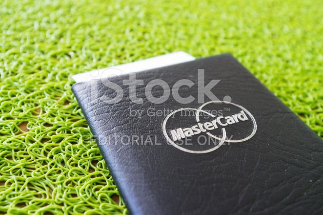 mastercard branded restaurant bill folder on green mat stock photos