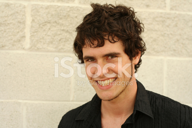 Smiling Young Man With Curly Hair Stock Photos - FreeImages.com