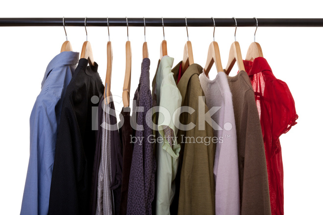 Clothing Hanging In Closet Stock Photos