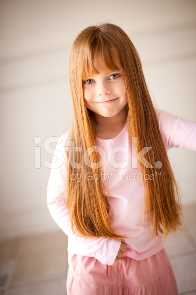 Color Image Of Smiling Little Girl With Long Red Hair Stock Photos