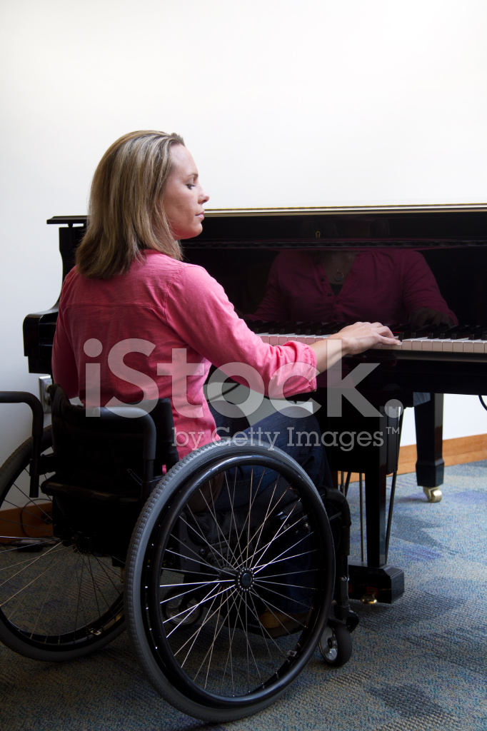 Woman In Wheelchair Playing Piano Stock Photos