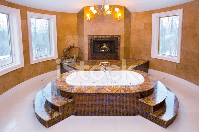 https://images.freeimages.com/images/premium/previews/1916/19162941-spacious-master-bathroom-whirlpool-tub-with-marble-fireplace.jpg