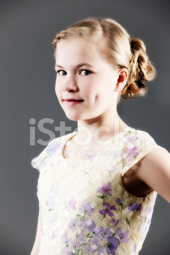 Beautiful Smiling 11 Year Old Girl On Grey Background