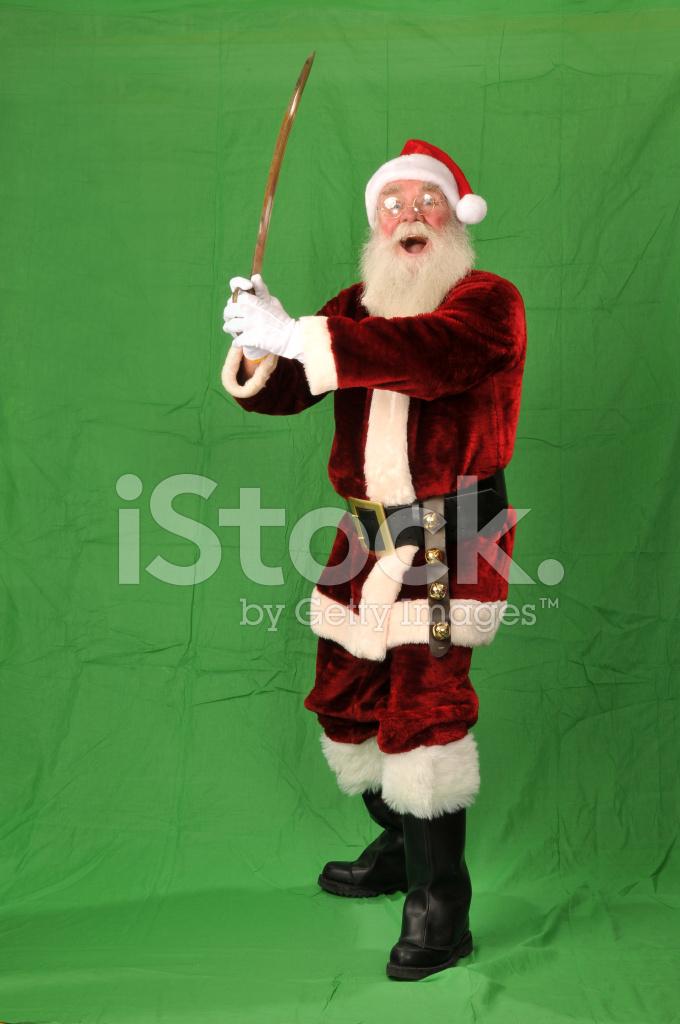 Santa claus holding a samaria sword on green screen stock