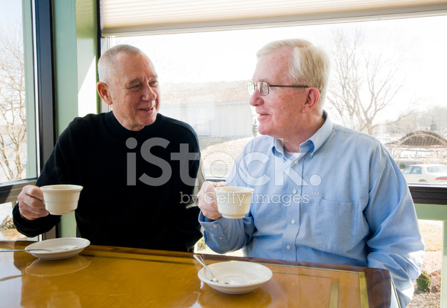 Senior Men Drinking Coffee IN A Restaurant Stock Photos